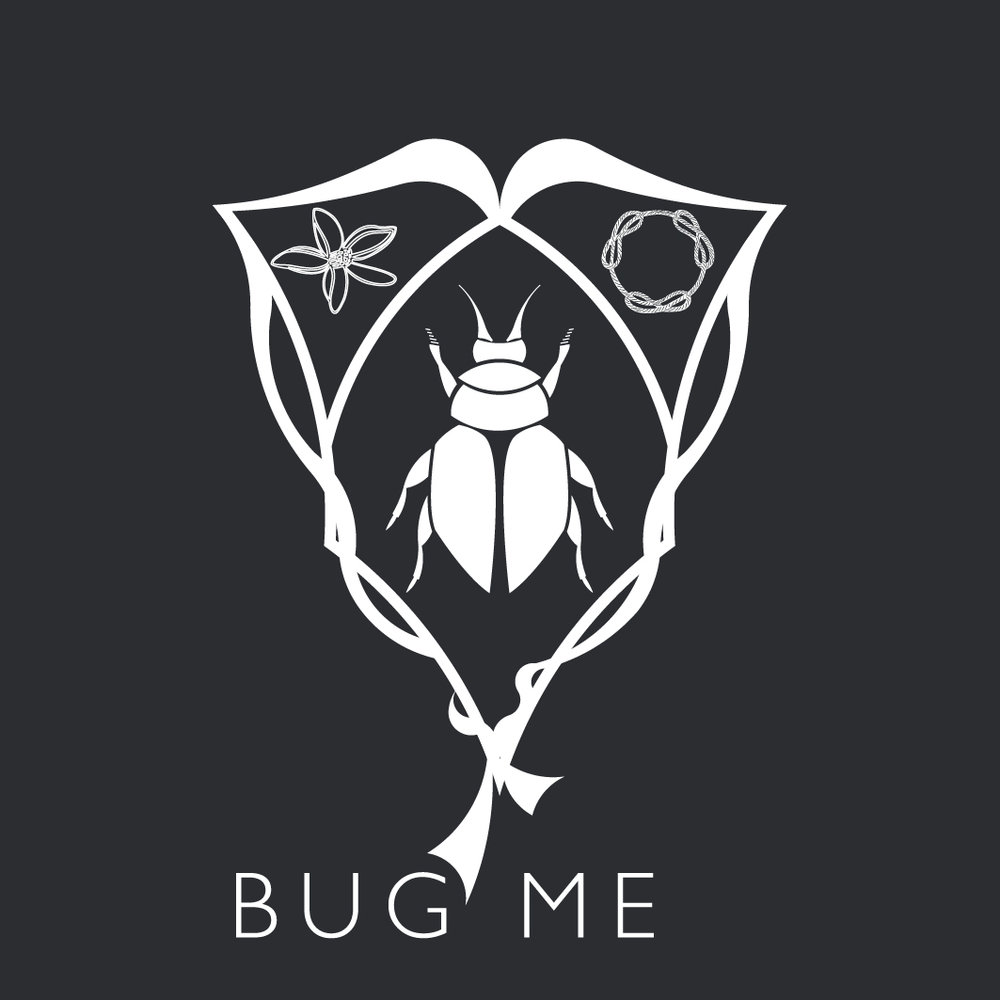 The Bug Me Studio - A laboratory of ideas - The Bug Me brand icon, the shield, represents unity in work, symbolised by the braided cord, with the three inseparable needles - like the osmosis between the two creative founders. The orange blossom reveals the beauty in the arts and the craftmanship, a strong point for Bug Me.