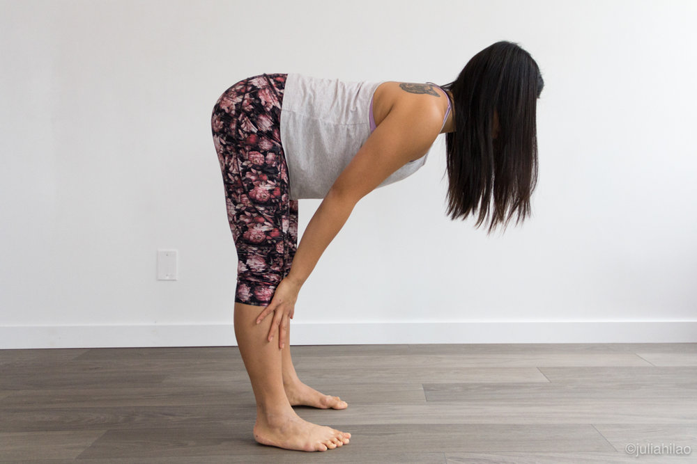 Hands on shins *MODIFIED* - Hands on shins, must press the weight forward in the feet to roll shoulders away from ears, draw navel to spine. Legs can be bent slightly for those with tight hamstrings, but there is less strain on the back body.