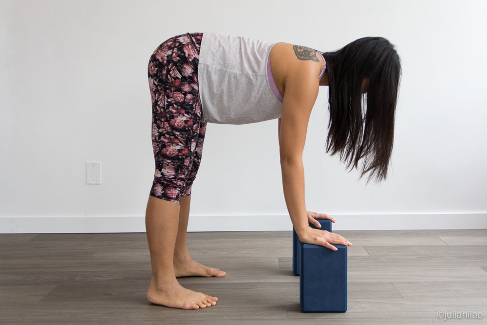 Hands on blocks *MODIFIED* - Hands are placed on blocks, weight shifts forward in the feet as shoulders are rolled back, navel is drawn to spine, as the tailbone points back in space.