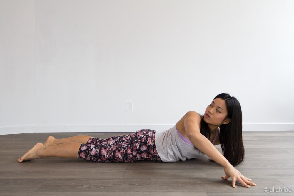 Cobra pose with a twist - Dip your left shoulder down, as you look over your right. Return back to center, chest forward. Dip your right shoulder down, as you look over your left.Repeat on both sides 2x.
