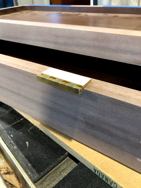 Double sided tape applied to only the portion of hinge to be mortised in the box.