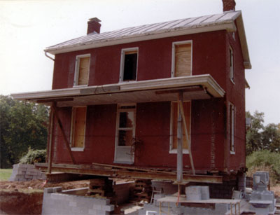 The Smith House being moved to the property in 1991.