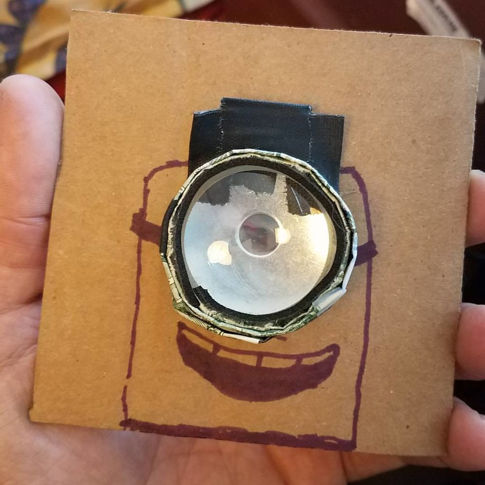 The (mostly) finished $4 Dollar Bill Lens, in it's cardboard cutout lens board. (un)Necessary decoration by yours truly.
