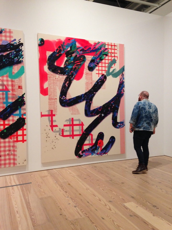 An exhibition goer marvels at Owens' virtuosity with paint