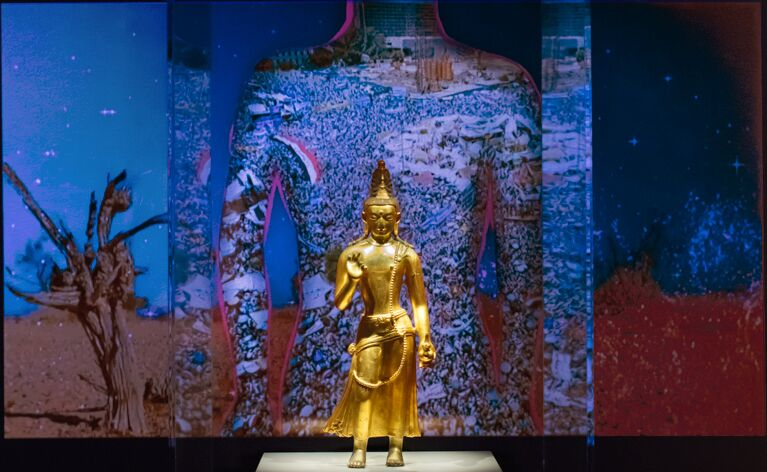 Chitra Ganesh;  Silhouette in the Graveyard ; 2018; digital animation; one minute, 22 seconds; dimensions variable; courtesy of the artist, animated and developed with the STUDIO, NYC.  Collection object: The One of Loving Kindness Maitreya; Mongolia; late 18th–early 19th century; gilt copper alloy with pigment; Rubin Museum of Art.