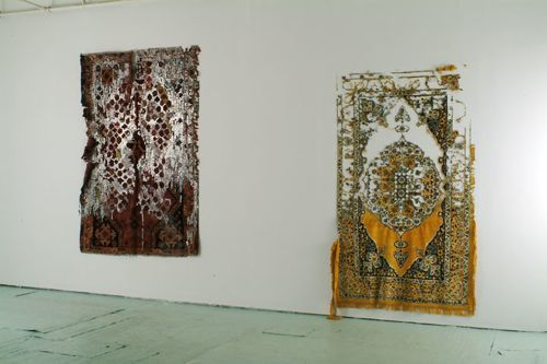 Civilization and its Discontents,     2003  Persian and Persian type carpets, mixed fabrics, metal staples, Dimensions variable  Installation view at Smack Mellon, Brooklyn, New York  Photo by Hermann Feldhaus
