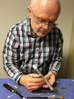 John in his shop.