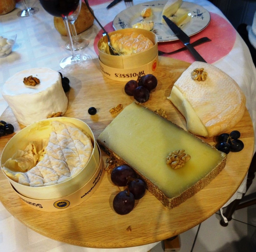 An assortment of French cheeses, fruit, nuts, and red wine - tis the season!