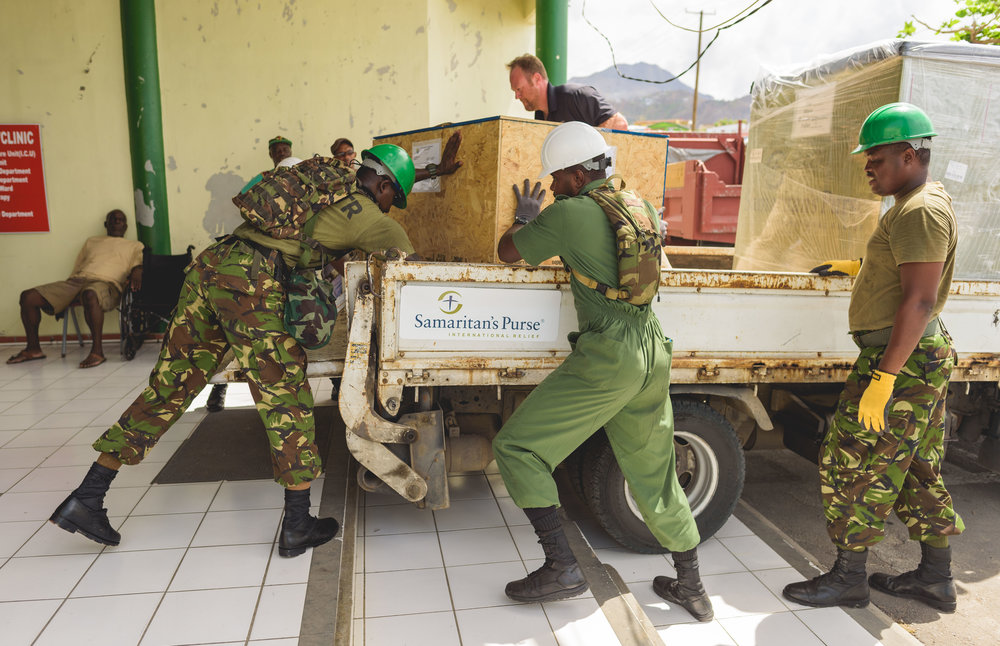 Roseau, Dominica - Military personnel unload water purification systems for the island.