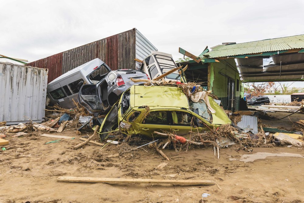Roseau, Dominica - Piles of mangled automobiles and other debris lie in the wake of the destruction caused by Hurricane Maria.