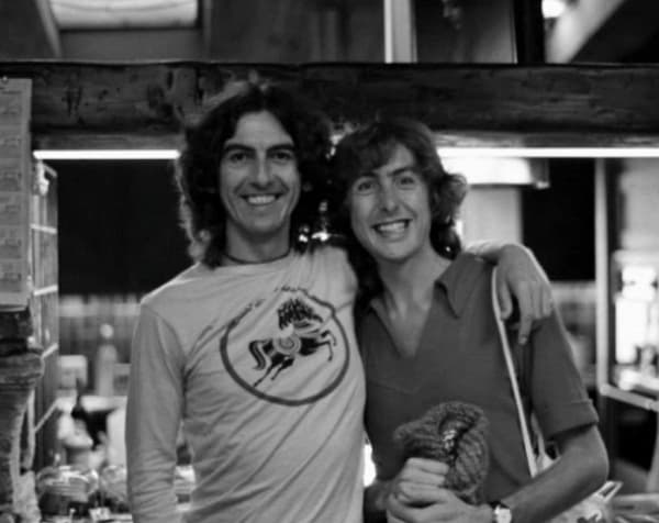 George Harrison and Eric Idle. [Source: HandMade Films]