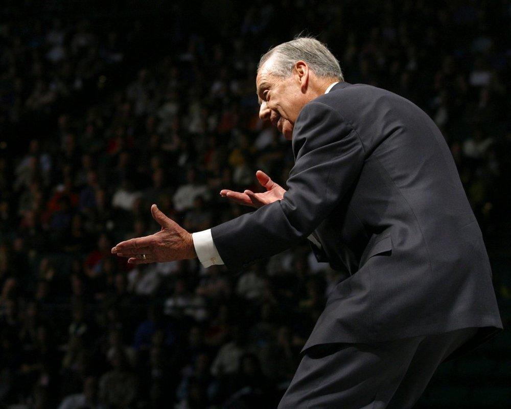 Zig Ziglar on stage speaking [Source:The New York Times]