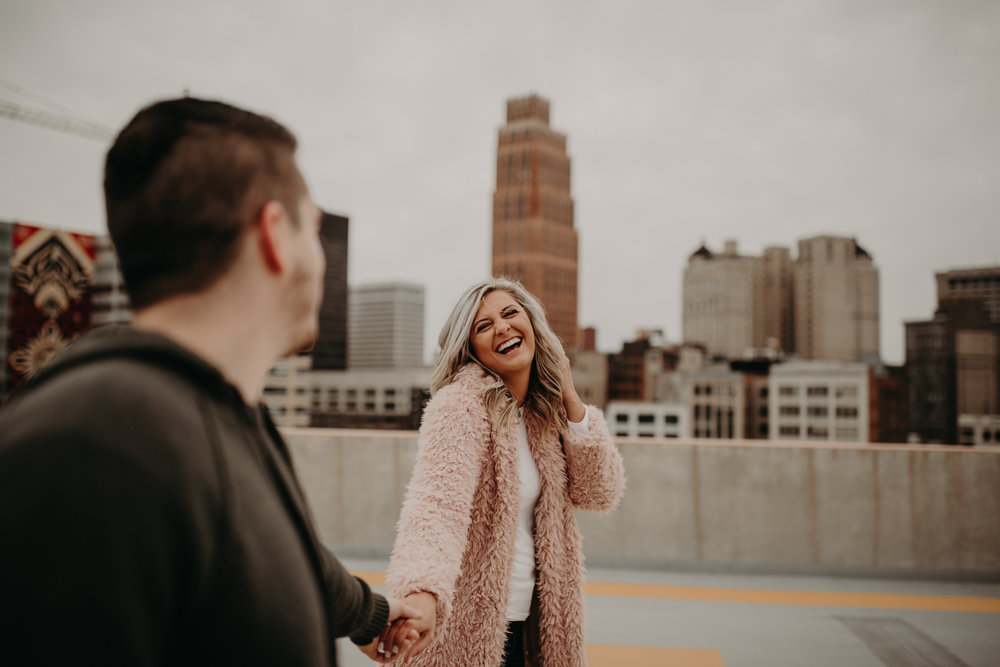 Girl with pink Target fur jacket smiling in the city
