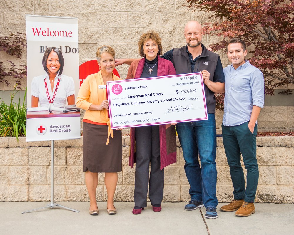 American Red Cross Check Delivery. Heidi Ruster, American Red Cross Utah Region, CEO, Jonee Woodard, COO, Sam Funk, President at Perfectly Posh, Brett Muramoto, Sr. Manager of Events & You Deserve It Foundation.