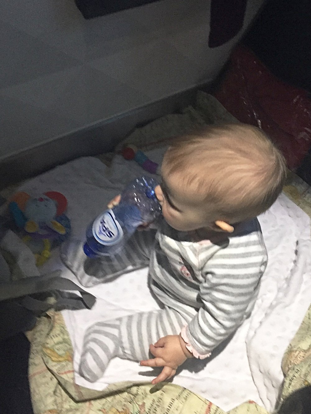 Baby travel tip: never underestimate the entertainment value of a water bottle.