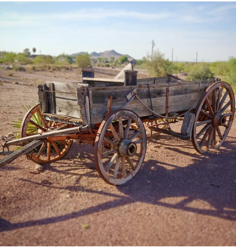 The wagon is 1900s. Purchased from the estate of Bob Hawkins child Hollywood actor, and radio anchor in 1940s. It served as a landmark for his home which was situated at the base of famous Superstition Mountains in Apache Junction AZ.