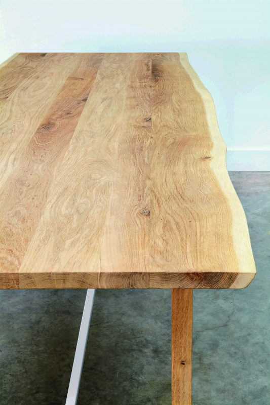 Many of the oak pieces have an imperfect, natural beauty to them such as the Squeeze table.