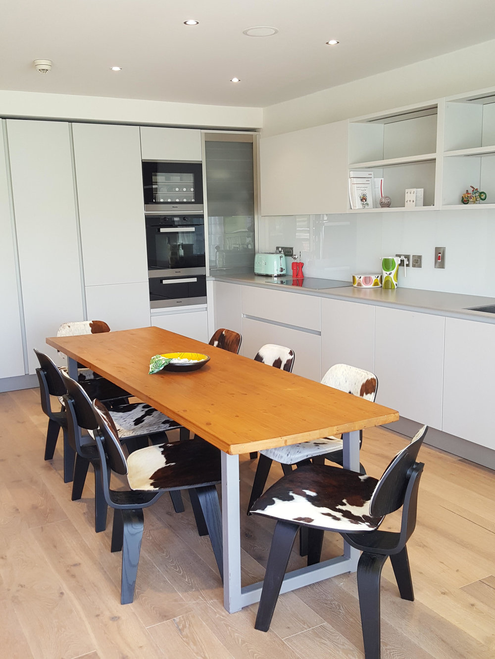 DUST   The Interior design consultancy and online interiors store used our DCW Eames-style cowhide chairs to finish for this Dublin kitchen renovation.