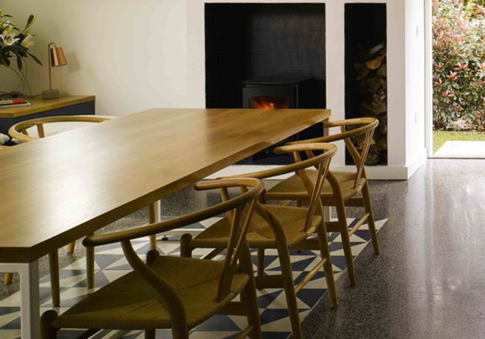 ALW Architects   Hans Wegner-style   wishbone chairs are used in this 'House in the Wood's' redesign by ALW architects, as seen in the Irish Times Home and Design section. Photo: Ros Kavanagh.