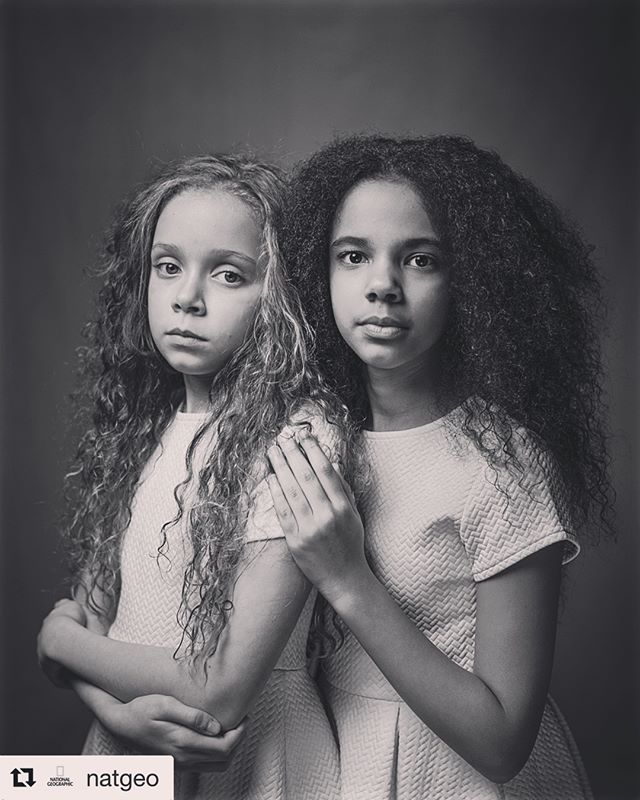 "RETHINK RACE @natgeo ・・・・ Photo @Hammond_Robin. I had the privilege of shooting the cover of this month's special issue on Race. 11 year old twins Millie (right) and Marcia (left) are from Birmingham, United Kingdom. Their mother calls them her ""rainbow twins."" ""They're my miracles"" she says. Race is a made-up label used to define and separate us. In its special race issue, @NatGeo reports on the origins of scientific racism and how it has defined society as we know it. #IDefineMe. I'll be sharing more images from the cover shoot and the feature I shot on genetics and race at @Hammond_Robin"