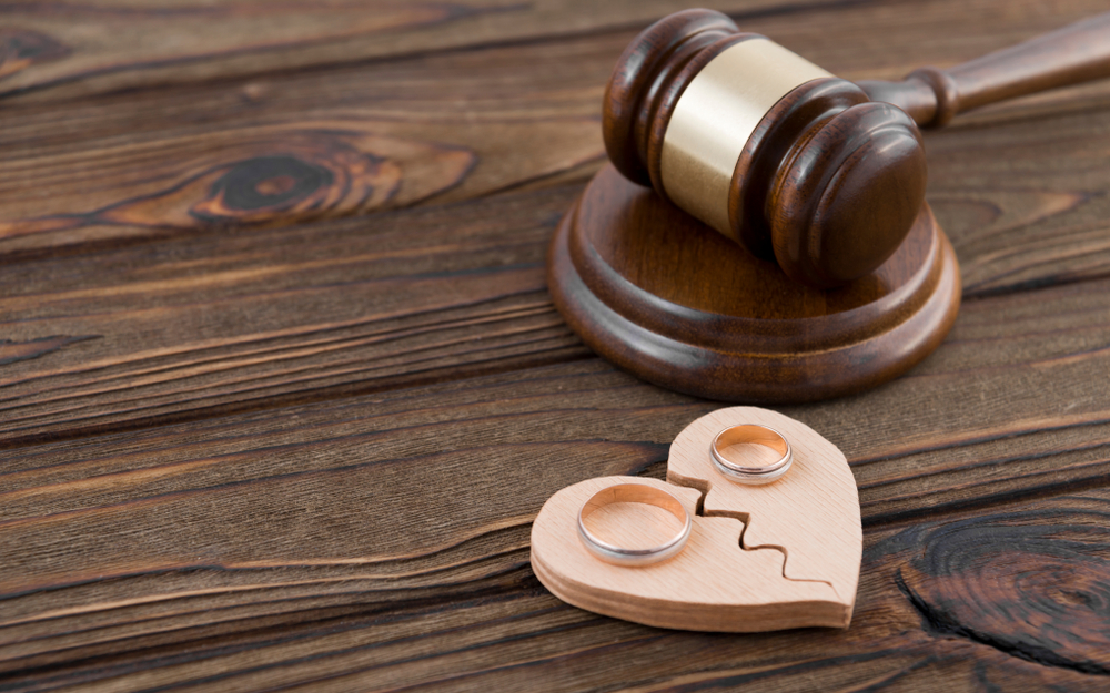 Judges Gavel And Two Rings Over The Heart