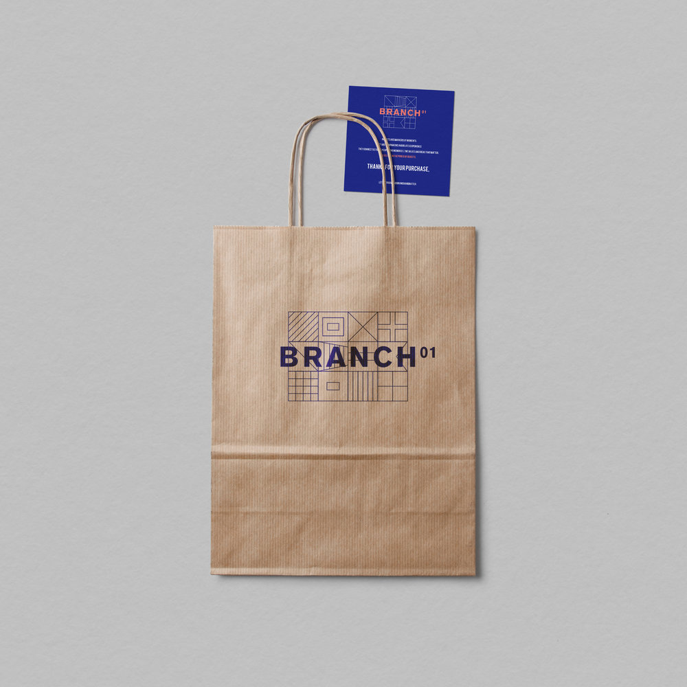 Brand - Marine flags convey messages without the use of words, and THIS THEME serves as the main design concept for Branch 01. Using both high and low cost boat-building materials, the space is a reflection of its nautical location.
