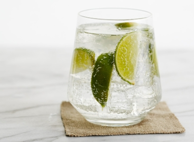 When I am in a club or lounge atmosphere, this is my go to. a shot of vodka, 6 ounces of club soda, as many limes as your heart desires.