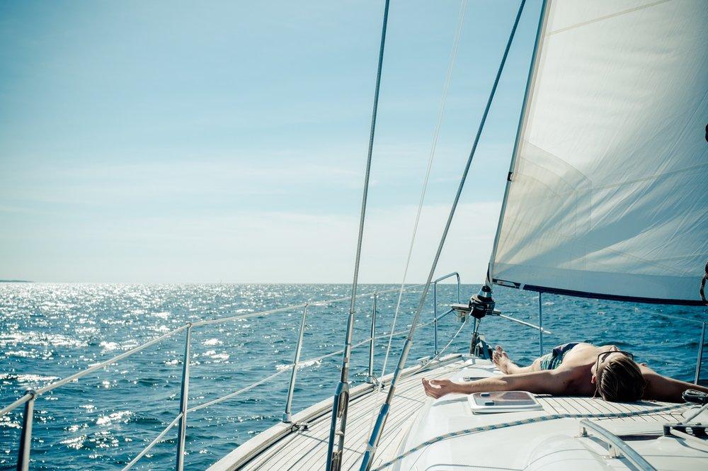 boy-on-a-sailboat-deck-in-the-tropics_t20_RlWLEB.jpg