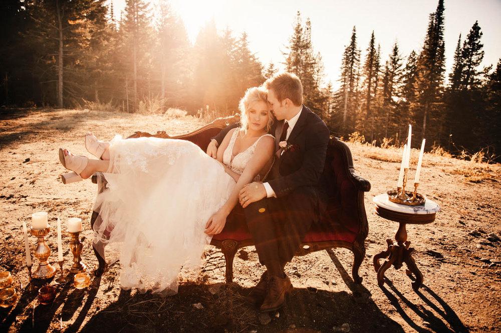 spokane wedding dress laying on couch with groom