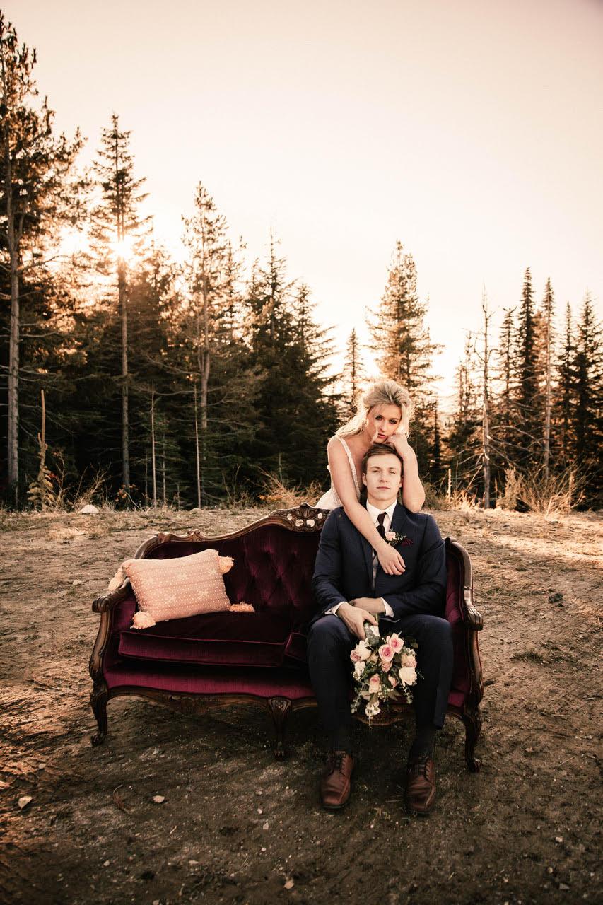 girl hugging groom on couch wedding dress image spokane
