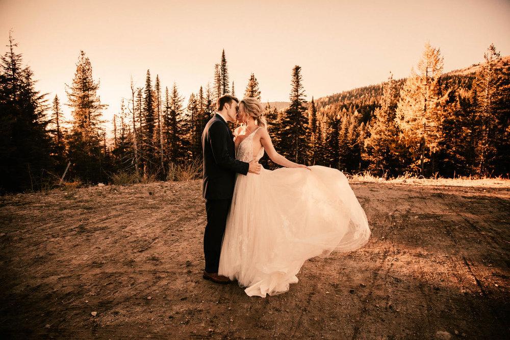 swirling and kissing image wedding dress spokane