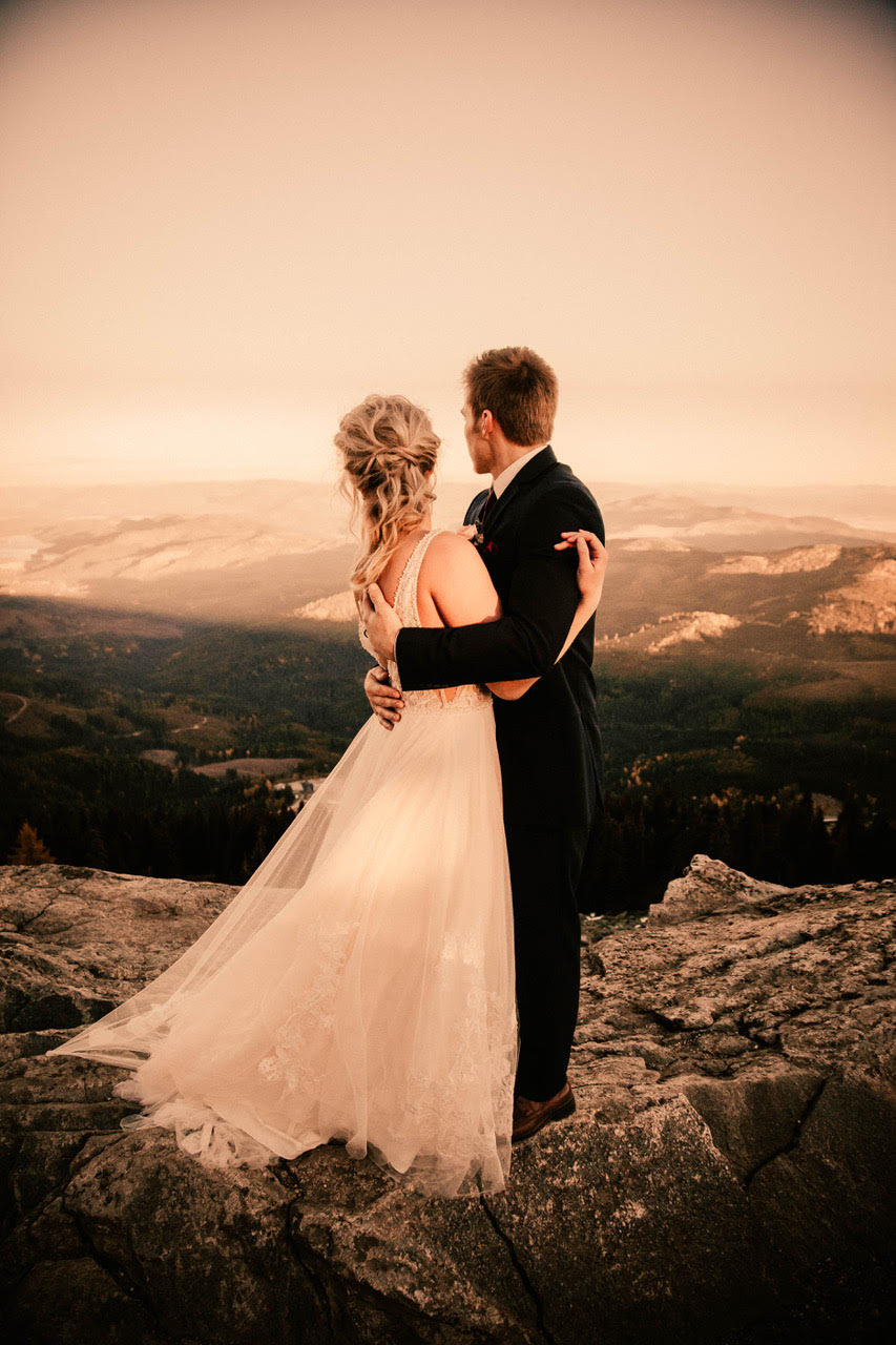 bride and groom looking out over my spokane in wedding dress