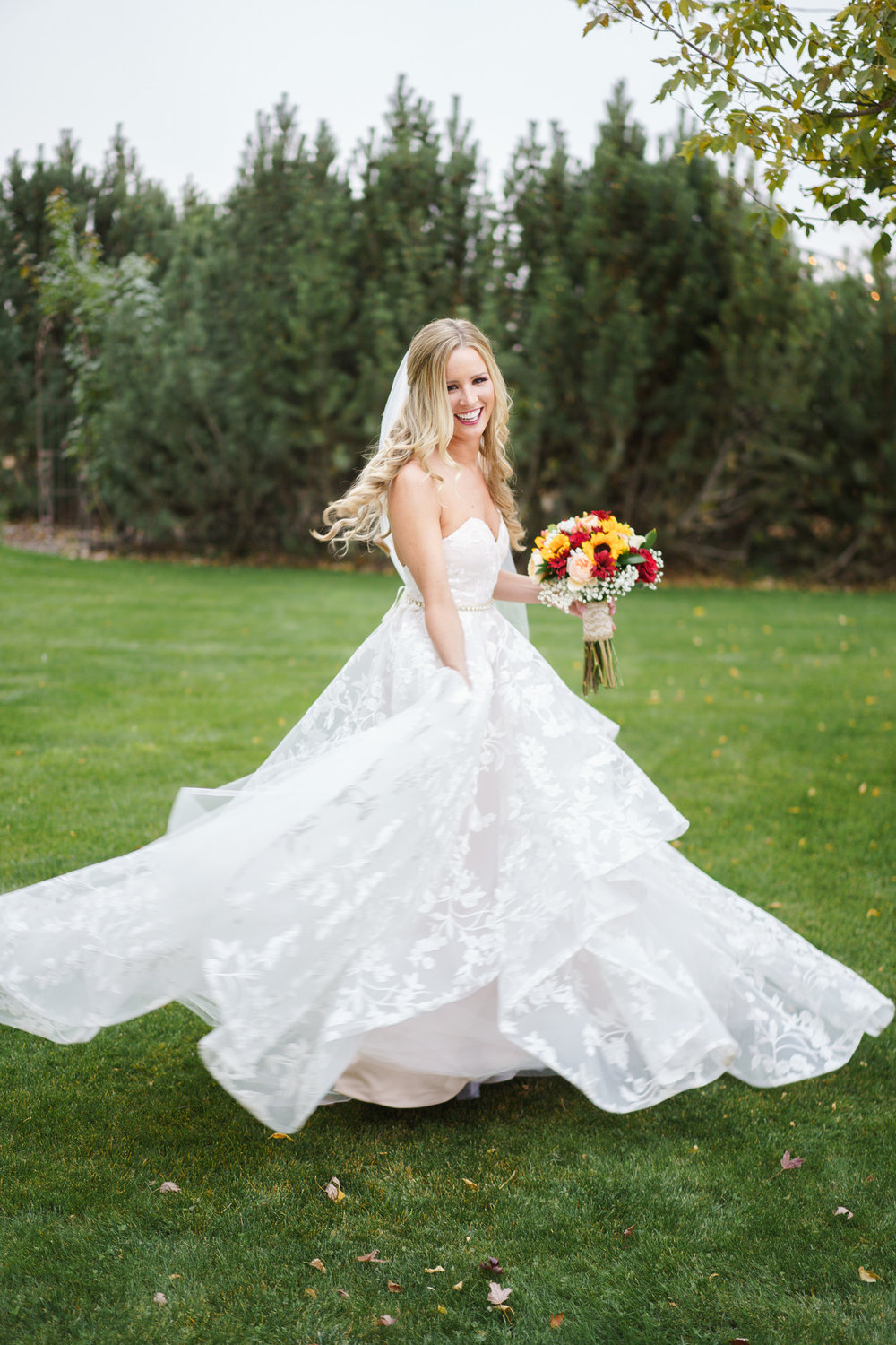 bride twirling in grass at touch of country spokane