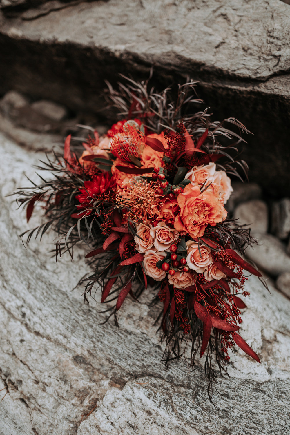 orange and red floral spokane wedding bouquet