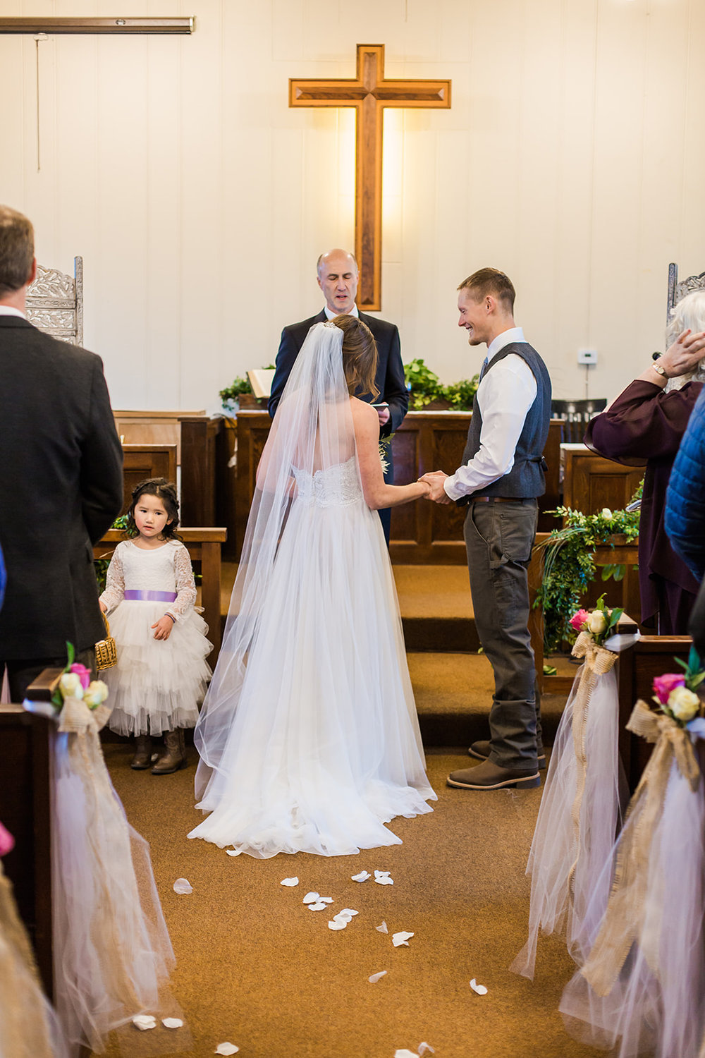 at the alter bride and groom spokane wedding dress