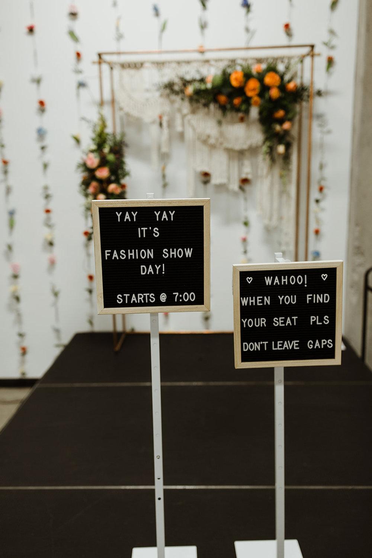 spokane wedding dress fashion show seating sign