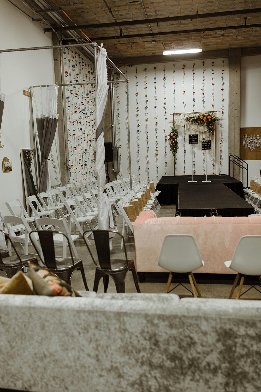 spokane wedding dress fashion show runway chairs gift bag fresh floral