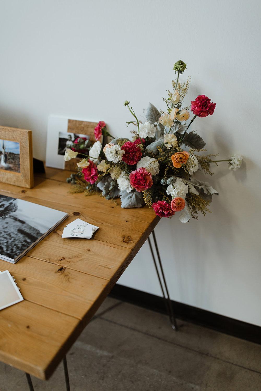spokane wedding dress fashion show floral stand photographer amy stone