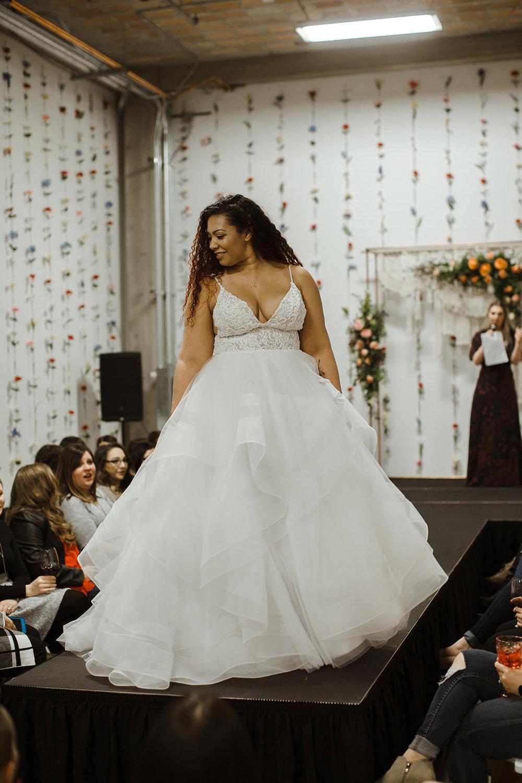 spokane wedding dress fashion show model walking the runway liz l'amour
