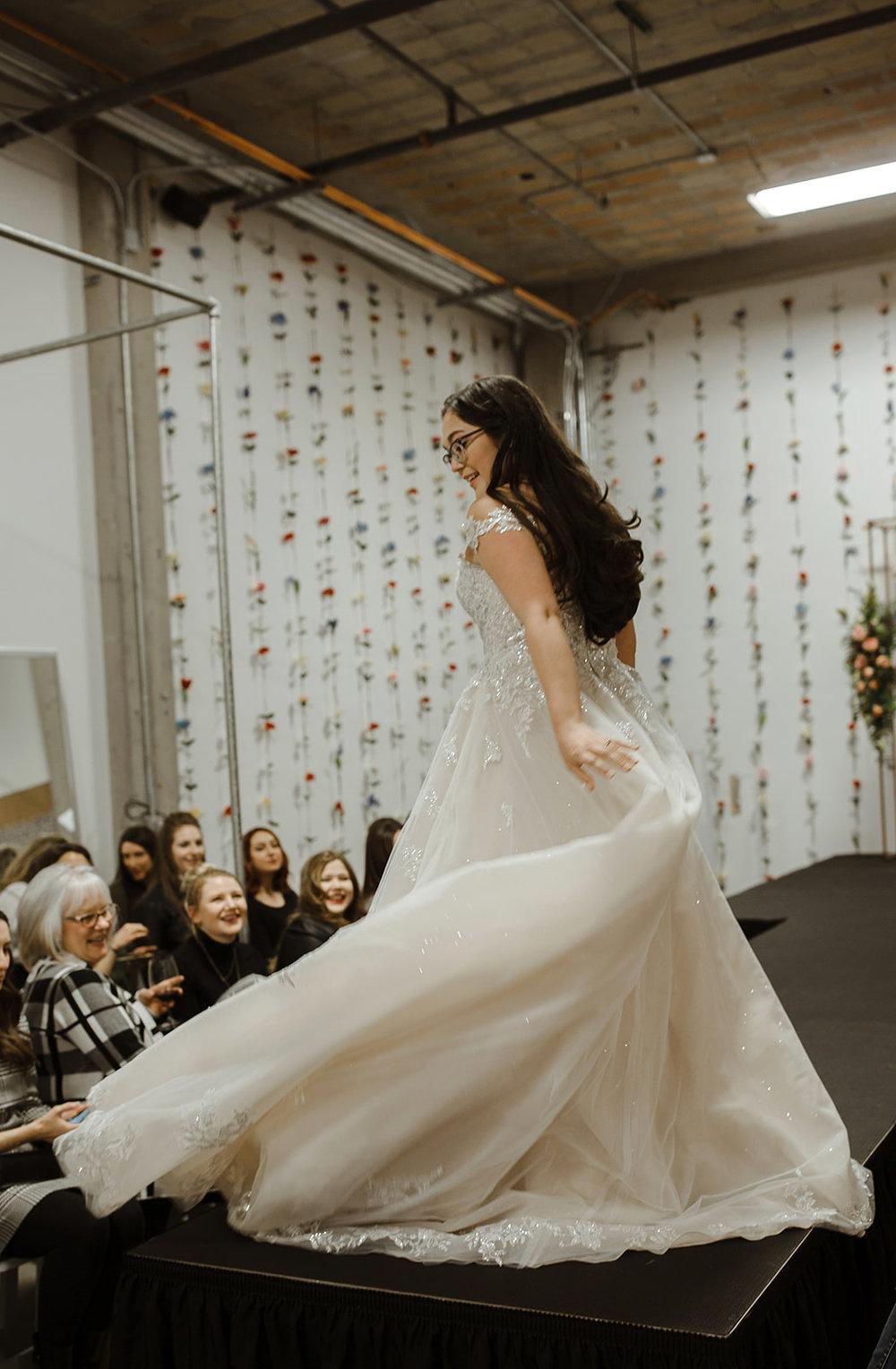 spokane wedding dress twirling end of runway fashion show