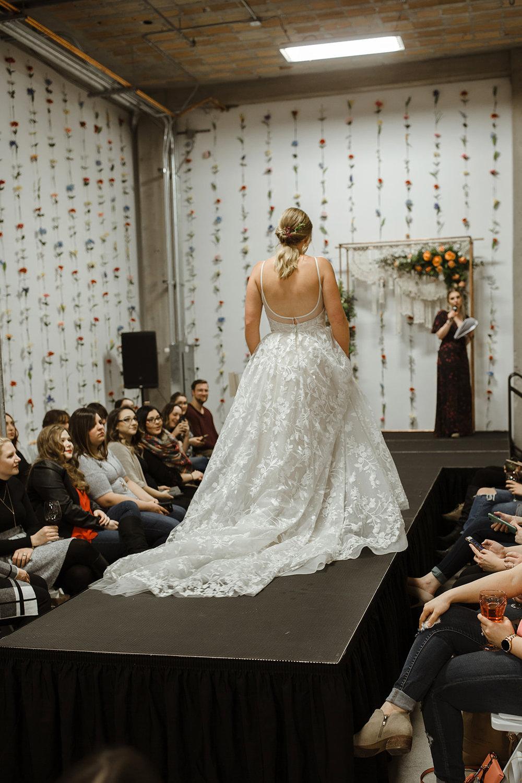 spokane wedding dress low back fashion show bridal model pony tail