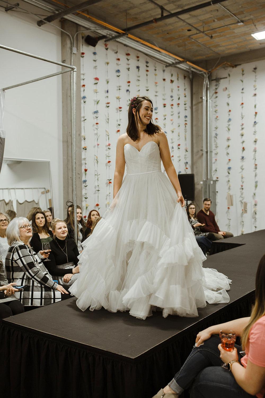 spokane wedding dress flower in hair twirl fashion show