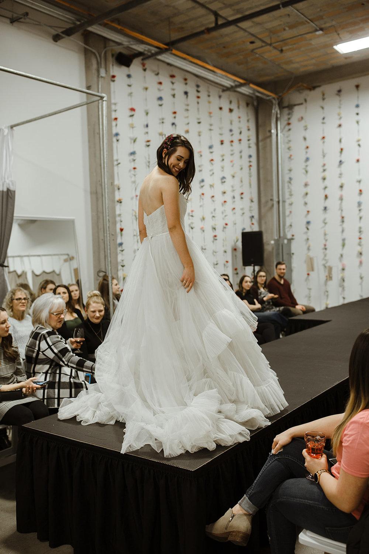 spokane wedding dress smile fashion show flowers in hair