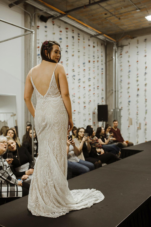 spokane wedding dress fashion show model over the shoulder glance