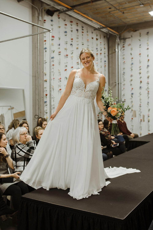 spokane wedding dress model fashion show laughing bouquet