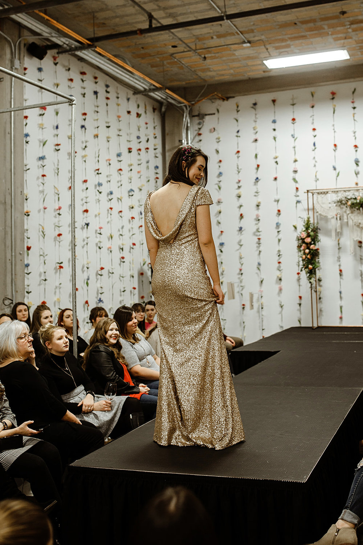 spokane wedding dress gold sparkle swoop back fashion show