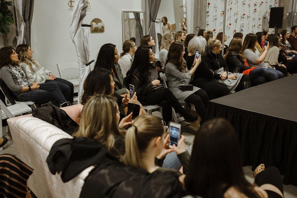spokane wedding dress fashion show phones photos crowd