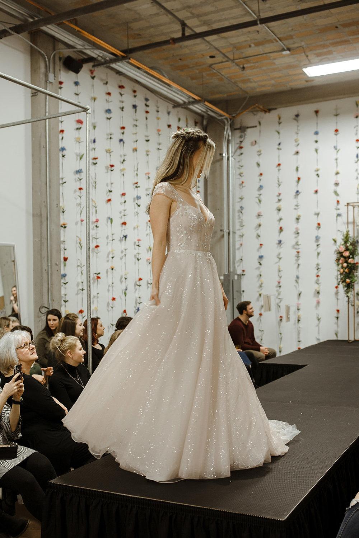 spokane wedding dress bride pink sparkle fashion show model runway