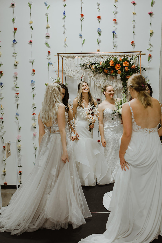 spokane wedding dress end of fashion show brides on runway laughing