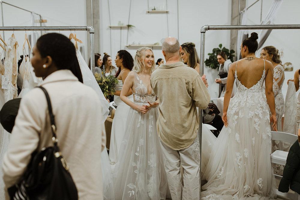 spokane wedding dress after fashion show mingling with guests celebration